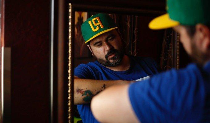 Admiring new tattoo in mirror