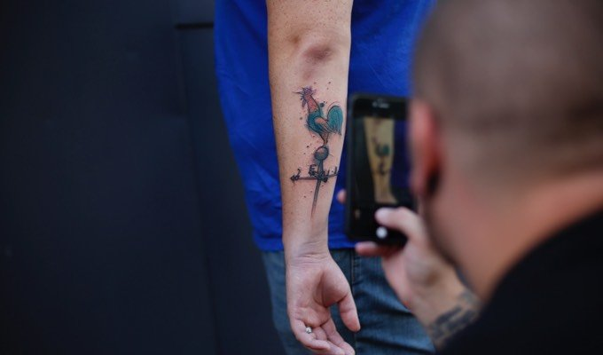 Photographing a finished tattoo outside of Hart & Huntington Tattoo Co. Orlando